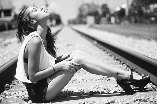 #model #train #tracks #heels #tank #high #waisted #shorts #cigarette
