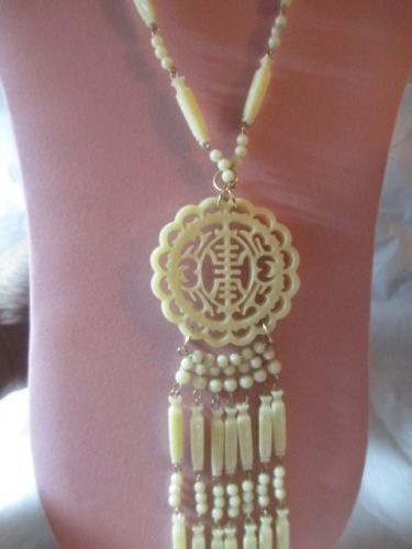 Carved lucite faux ivory oriental chinese pendant necklace on wires carved lucite faux ivory oriental chinese pendant necklace on wires vintage ebay aloadofball Choice Image