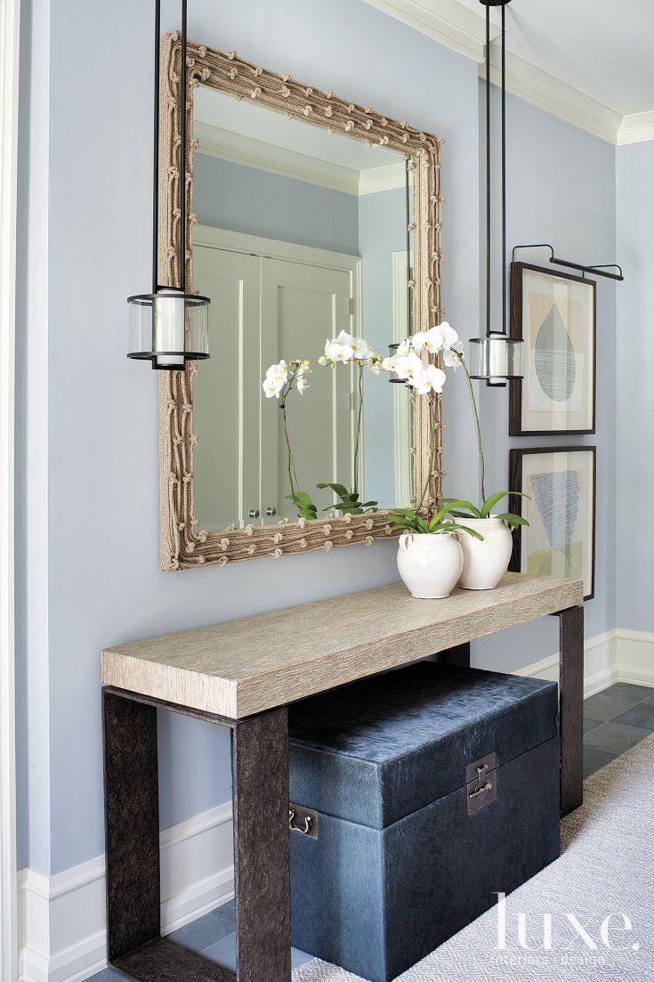 Foyer Table Vignettes : Blue trunk under a neutral vignette enter foyer