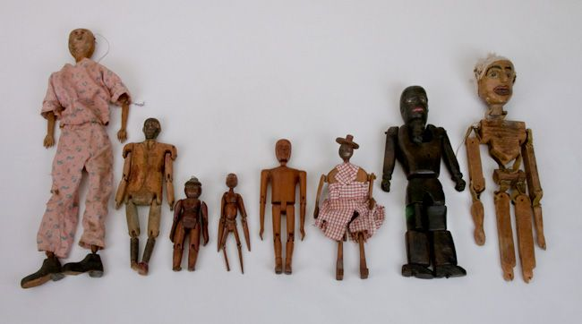 Limberjacks or jig (dance) dolls. Made in the late 19th and 20th century they are hand carved, jointed or articulated dolls attached to a stick. Their function was that of a musical instrument.