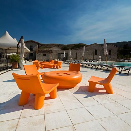 Low Lita orange and modern Slide design, Outdoor spaces