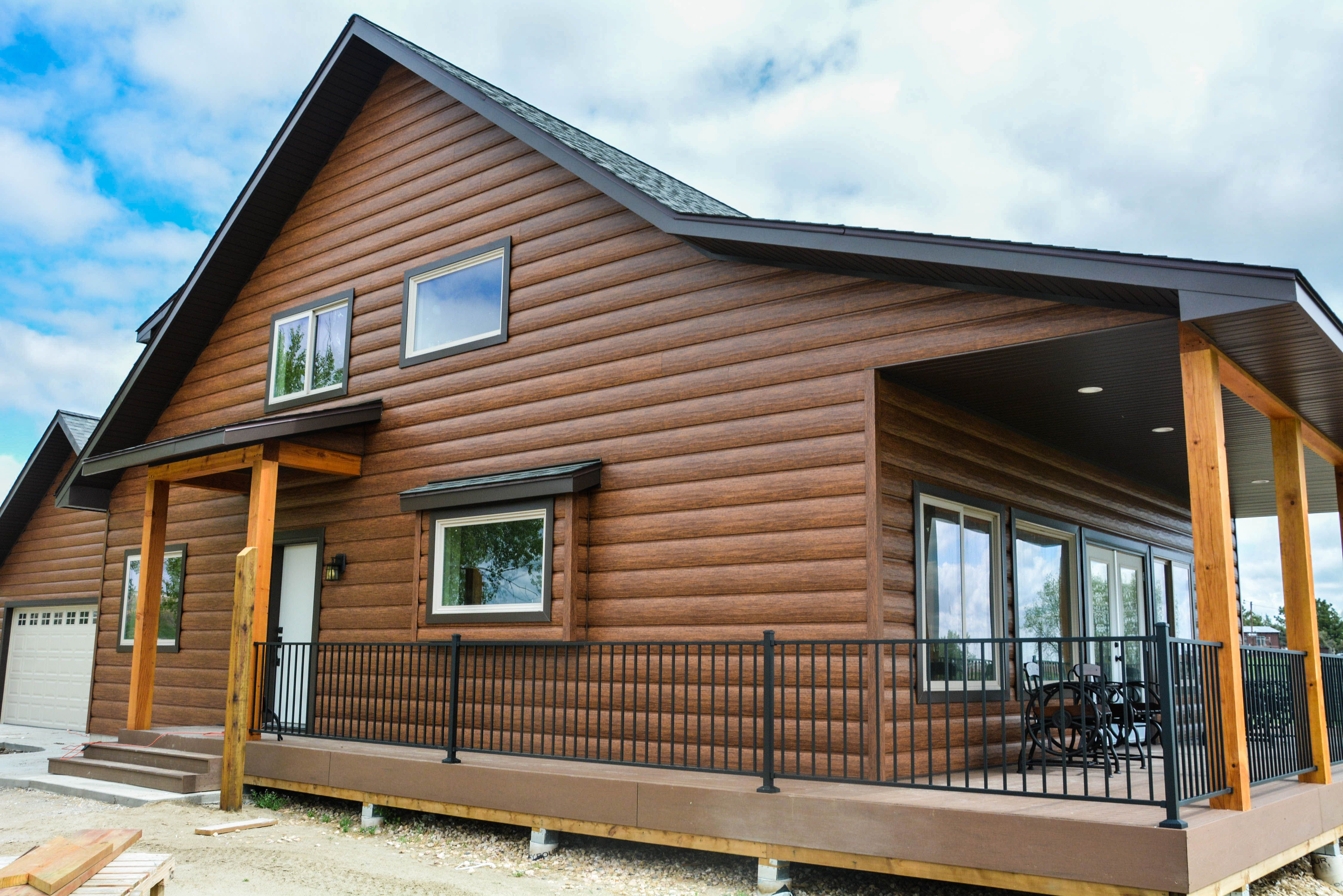Red Cedar Log Cabin In The Country Love This Porch And Dark Brown Trim Who Wouldn T Want Log Siding On Their Log Cabin Exterior Steel Siding House Log Siding