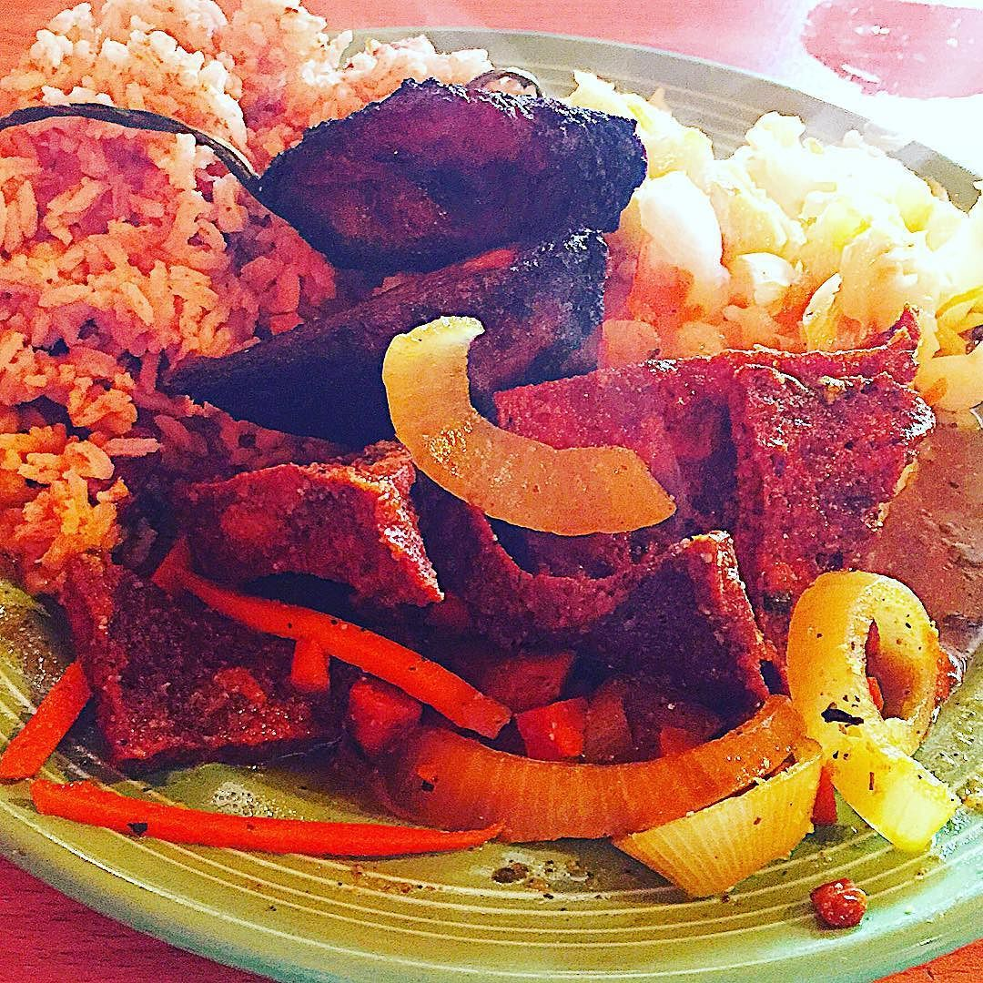 Jamaican escovitch tofu! Sooo tangy sooo spicy sooo good  It came with sweet plantains amazing cabbage beans and rice! by the_meatless_man