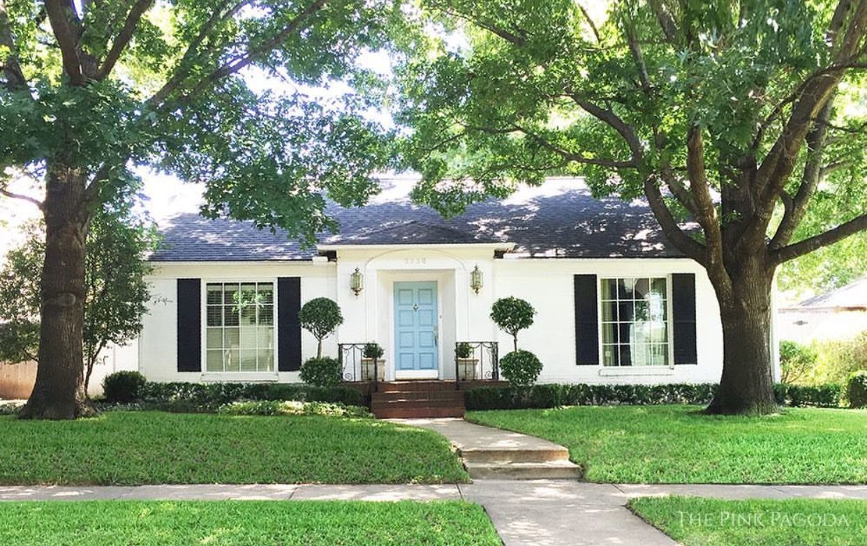 Image result for white brick house with blue door
