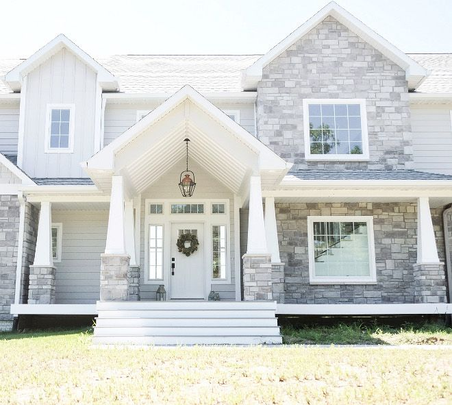 Love the white front door and exterior grey stone the for Gray stone paint color