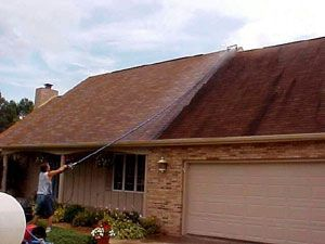 cleaning gutters with a pressure washer