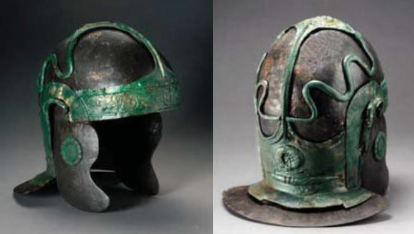 Roman cavalry helmet, type Nederbieber III. The decoration consists of a band of hair curls across the forehead, which is connected by a narrow band to a plate on the neck guard by way of a plate with a rosette on the top centre of the helmet. On the neck guard plate there is a wreath and a thunderbolt. From the top centre of this plate two snakes crawl along the sides up to the top of the helmet. Archäologisches Landesmuseum Schleswig