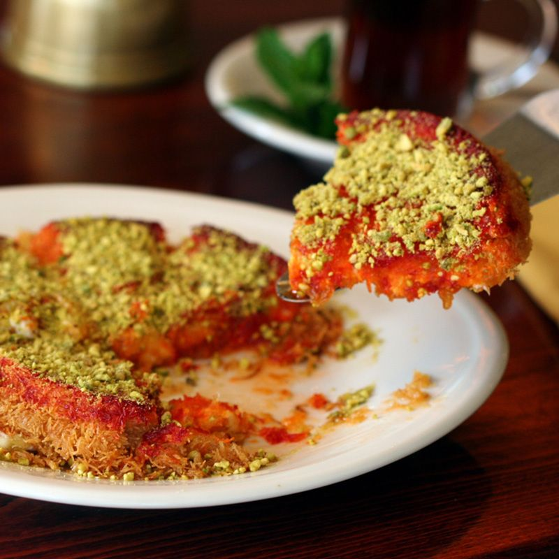 """""""Knafeh"""" (crispy layers of filo dough stuffed with home-made sweet cheese, soaked in orange blossom syrup and topped with crunchy pistachios.)"""