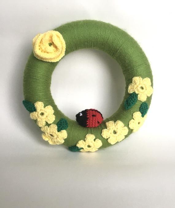 Photo of Crochet Wreath, door/wall hanging.  Large crochet floral wreath.  Handmade crochet flowers and ladyb
