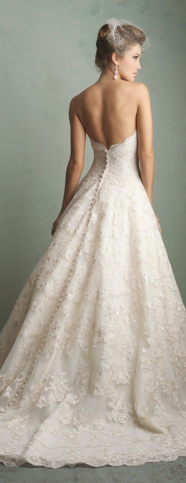 Lace keyhole back wedding dress  Strapless low back all lace gown with buttons to the bottoms