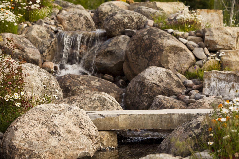 Stone bridge with waterfall and stream
