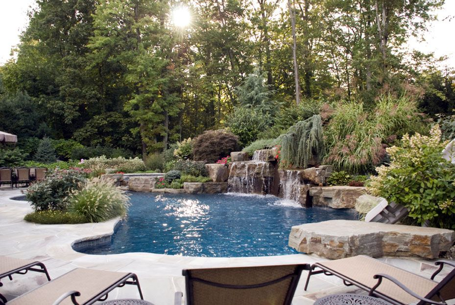 15 pool landscape design ideas waterfall swimming pool - Amazing Swimming Pool Designs