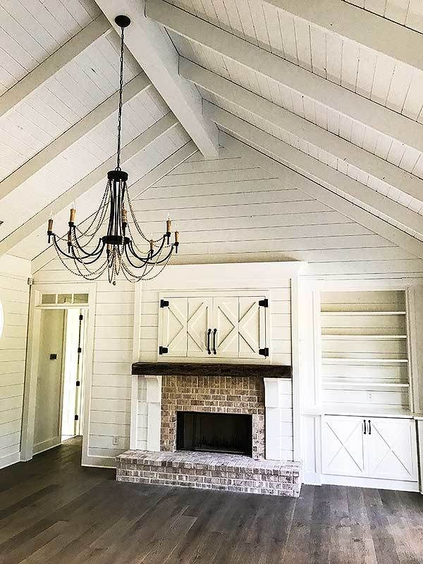 White shiplap Vaulted Ceiling, black chandelier, old ...