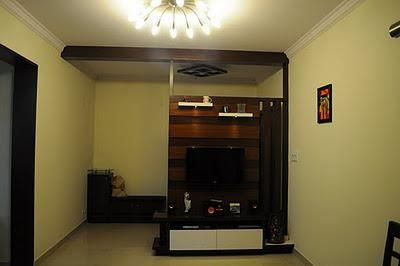 entertainment unit as a room divider in the living room