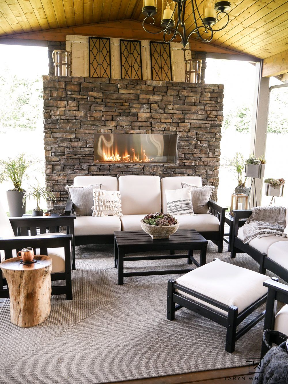 This Gorgeous Black And White Outdoor Furniture Makes E Feel So Luxurious The Neutral Tones With Stone Fireplace Create A Soft Cozy Living