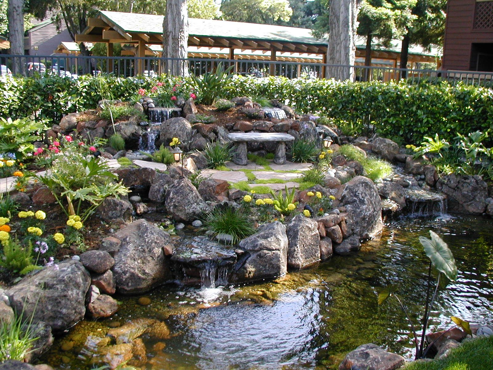 Landscape water features alexander sons water feature for Garden pond fountain design