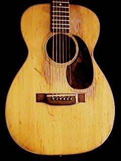 1950 acoustic Martin O-18 guitar.