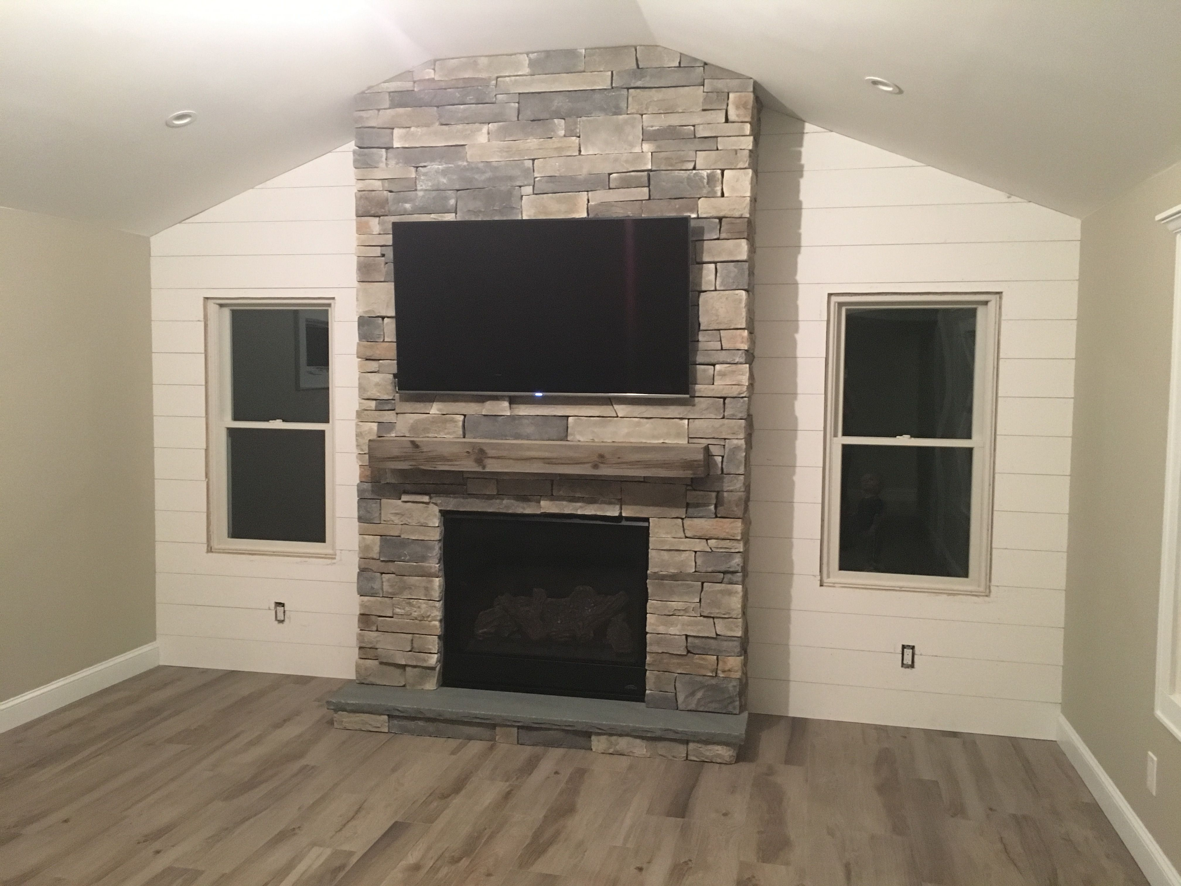 Fireplace with Magrahearth mantel and shiplap wall  Fireplace  Ship lap walls Deck decorating