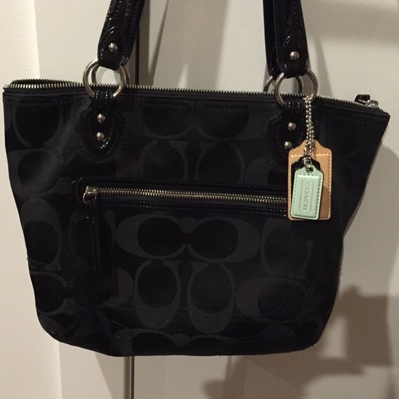 Coach purse Good condition, black with monogram, coach tags, teal inside. Coach Bags
