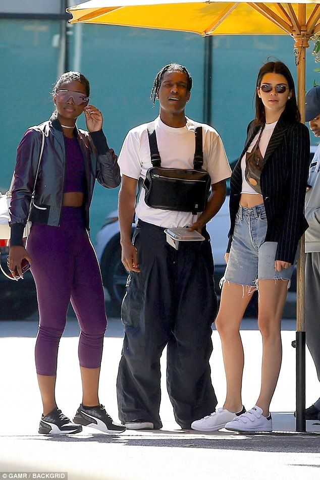 80c93048898c Just hanging: A$AP, 28, had on a white t-shirt and very baggy dark pants  along with sneakers and he wore a bag strapped to his chest
