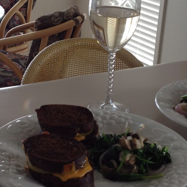 Grilled cheddar and apples on pumpernickel with honey mustard. Yum!
