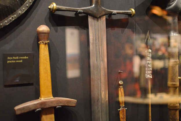 """The greatsword of House Stark, """"Ice,"""" was hand-forged using a technique called pattern welding and took three weeks to make. The detailing on the blade is (somewhat) visible through the glass."""