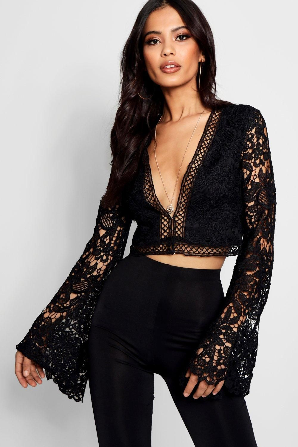 0e4c25ddcf7585 Click here to find out about the Flare Sleeve Plunge Lace Crochet Crop from  Boohoo