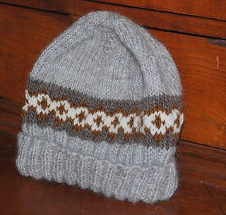 This nice little hat knits up fast, feels great in Lamb's Pride and gets tons of compliments! If you have never done 2 color knitting, get started with this pattern, the carries are never more than 4 stitches and the pattern is easy to follow.