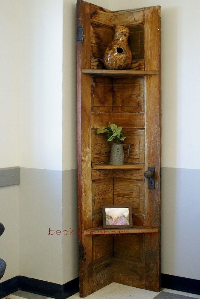 A corner shelf made from a vintage door.