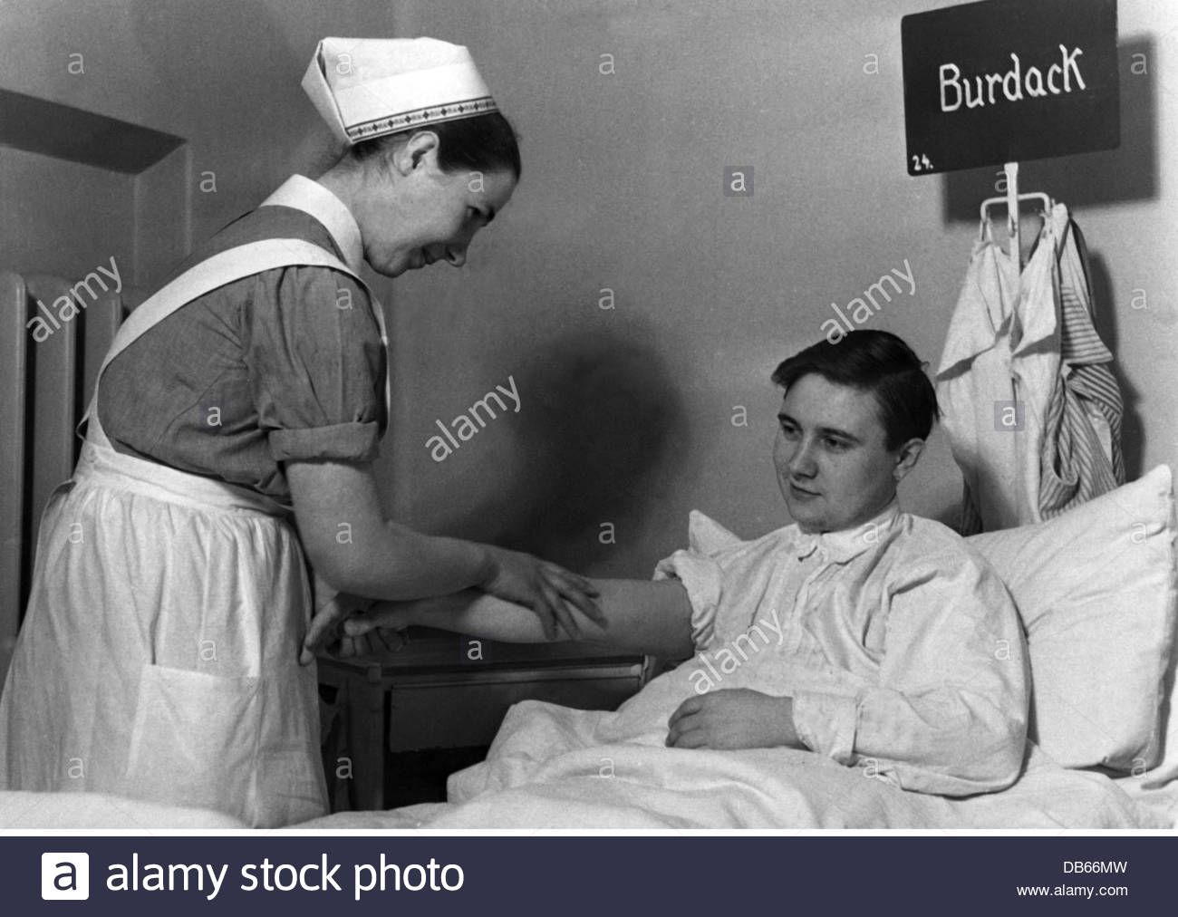 Download this stock image: medicine, hospital, interior, Red Cross nurse keeping a man, Germany, late 1930s, German Red Cross, DRK, people, women, Third Re - DB66MW from Alamy's library of millions of high resolution stock photos, illustrations and vectors.