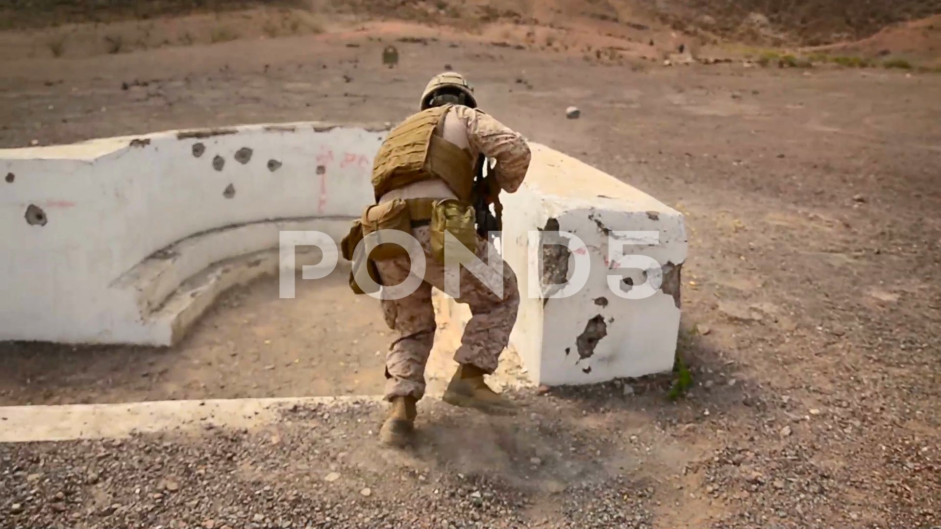 A soldier practices throwing a hand grenade during a live fire