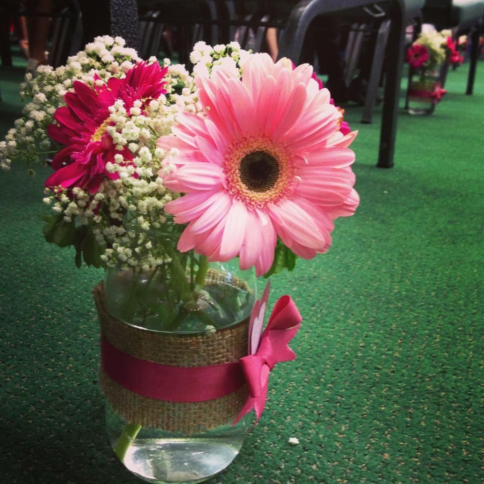 Neutrals pink mason jar flower arrangement along the for How to arrange flowers in mason jar