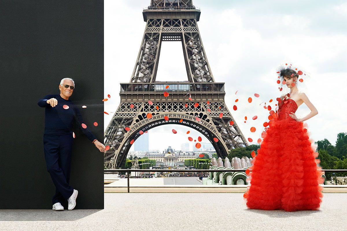 City of Love. The designer showcases a dress that's as monumental as the Eiffel Tower. #GiorgioArmani Privé dress and veil.