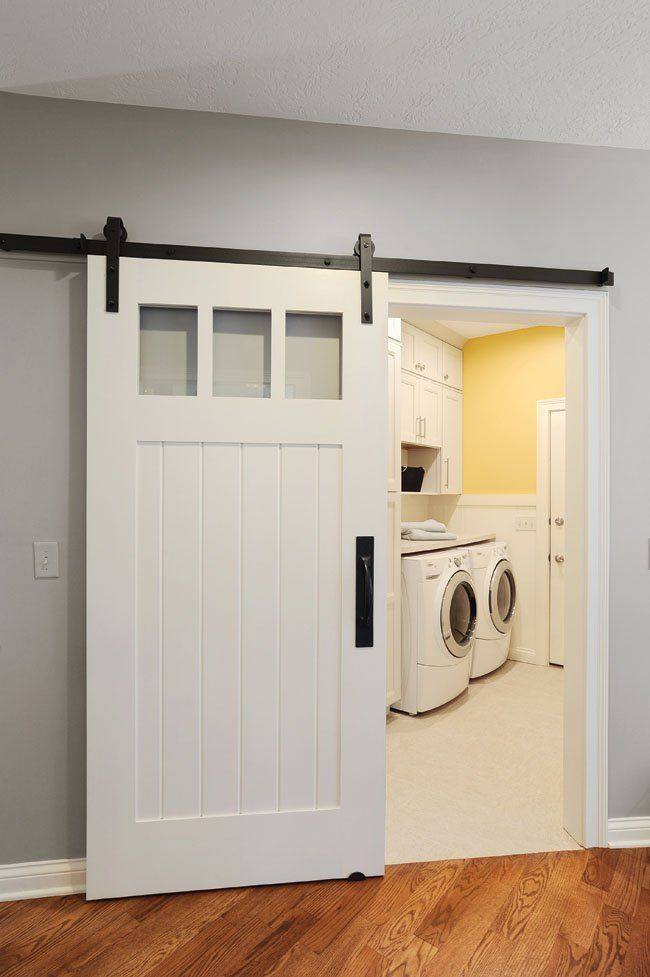 Sliding Doors Add Boundaries Between The Kitchen And Laundry Rooms