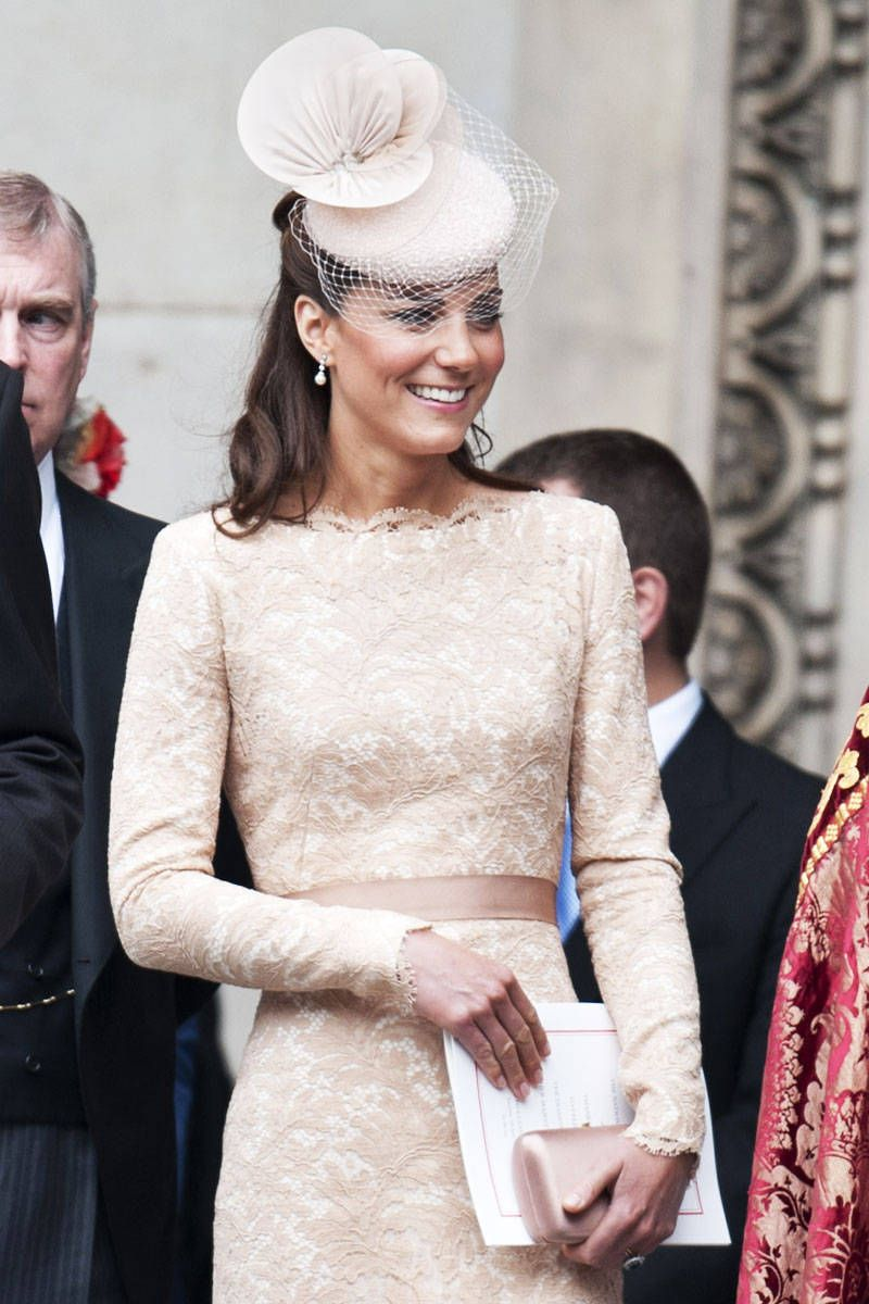 A headpiece adds drama to a lace Alexander McQueen ensemble that Catherine, Duchess of Cambridge chose to wear at the National Service of Thanksgiving at St. Paul's Cathedral in London.   ~ ELLE.com
