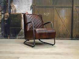 Afbeeldingsresultaat voor leren fauteuil bruin met footstool thuis