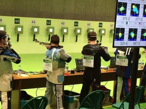 Lucas Kozeniesky sets up a shot during the 10-meter air rifle competition Monday at the Olympics in Rio de Janeiro. Kozeniesky, a rising senior at N.C. State, finished 21st overall, the top American.