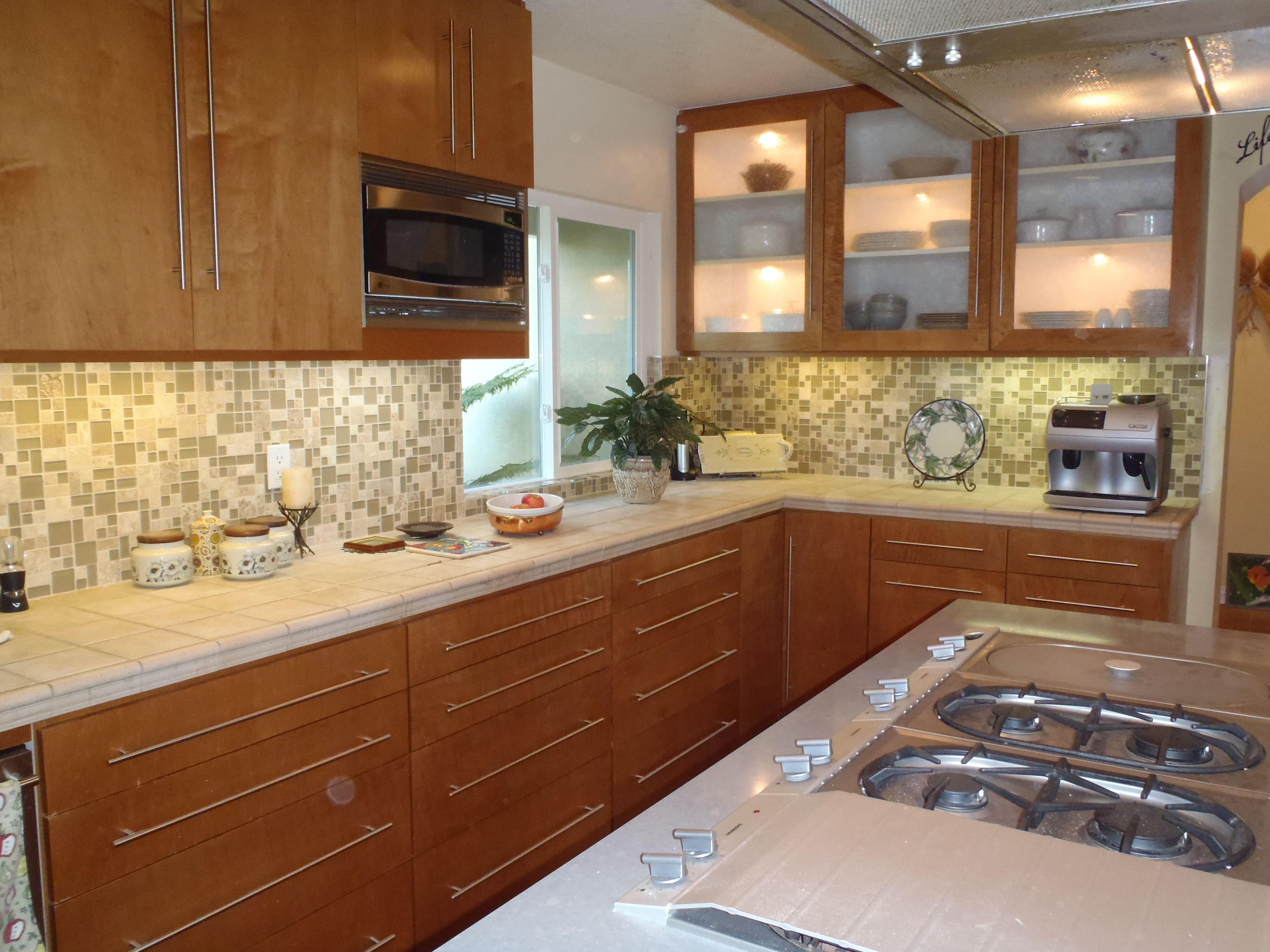 Kitchen Remodel Cabinetry, Tile Countertops, And Glass Mosaic Backsplash By