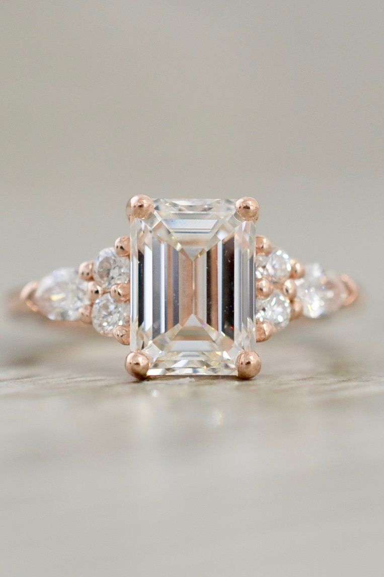 Emerald diamond flanked by round u pear cluster in rose pavé