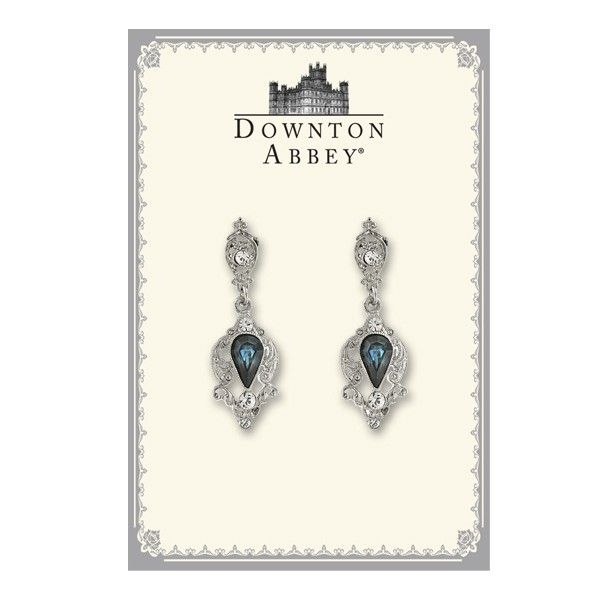 A match made in heaven, this pair of unique post drop earrings skillfully combine silver and crystal accents to spotlight a gorgeous Montana blue glass stone that sparkles and shines at every move. Presented in an elegant Downton-Abbey themed gift box.