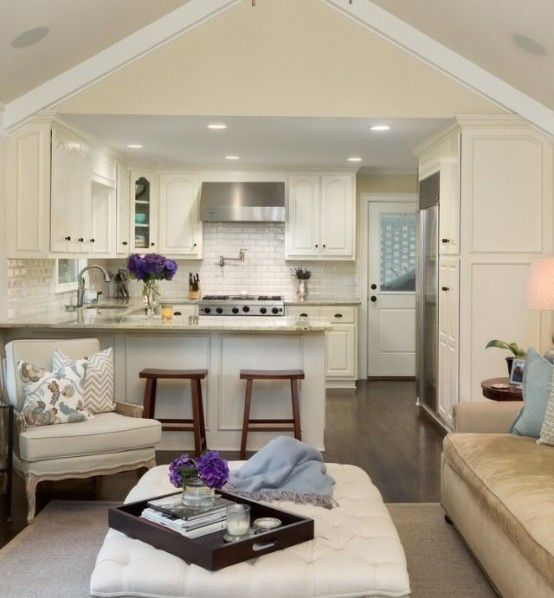 Vaulted beamed ceilings open kitchenette to living