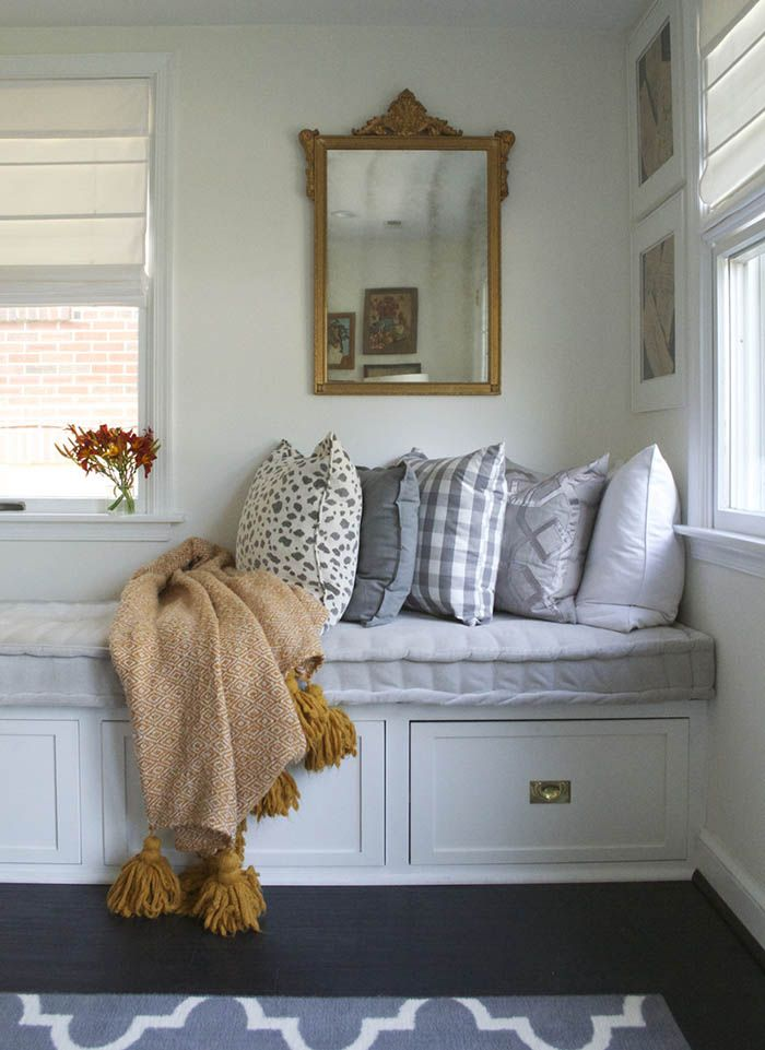 Relax Here: Eclectic Window Seat Style Adorned With Comfy Pillows.