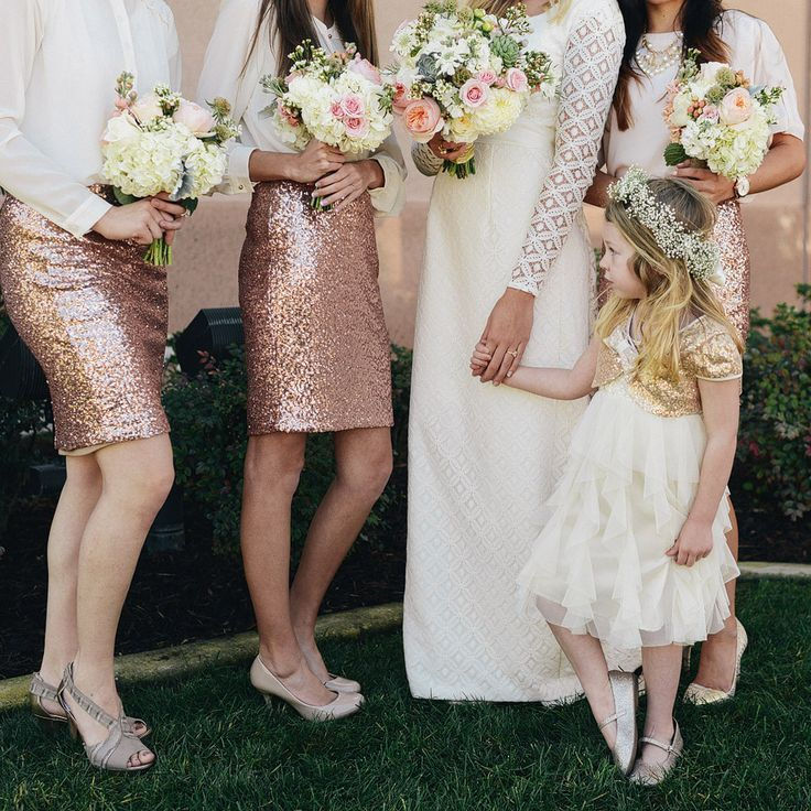 Unique bridesmaid style in sequined dresses and white blouses
