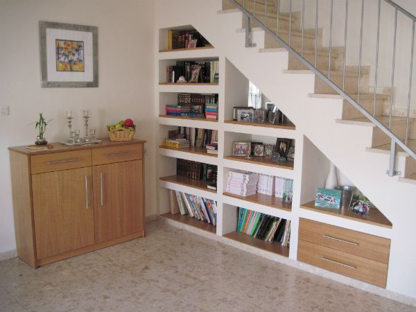 Charming Built In Bookshelf And Drawers Under The Stairs   Using Design Constraints  To Create More Inspiring Interiors