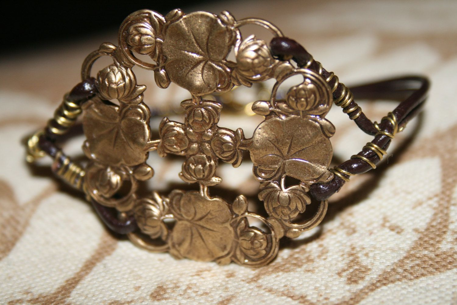 Floral pendant and leatehr cord bracelet by JeannineMarieJewels, $30.00
