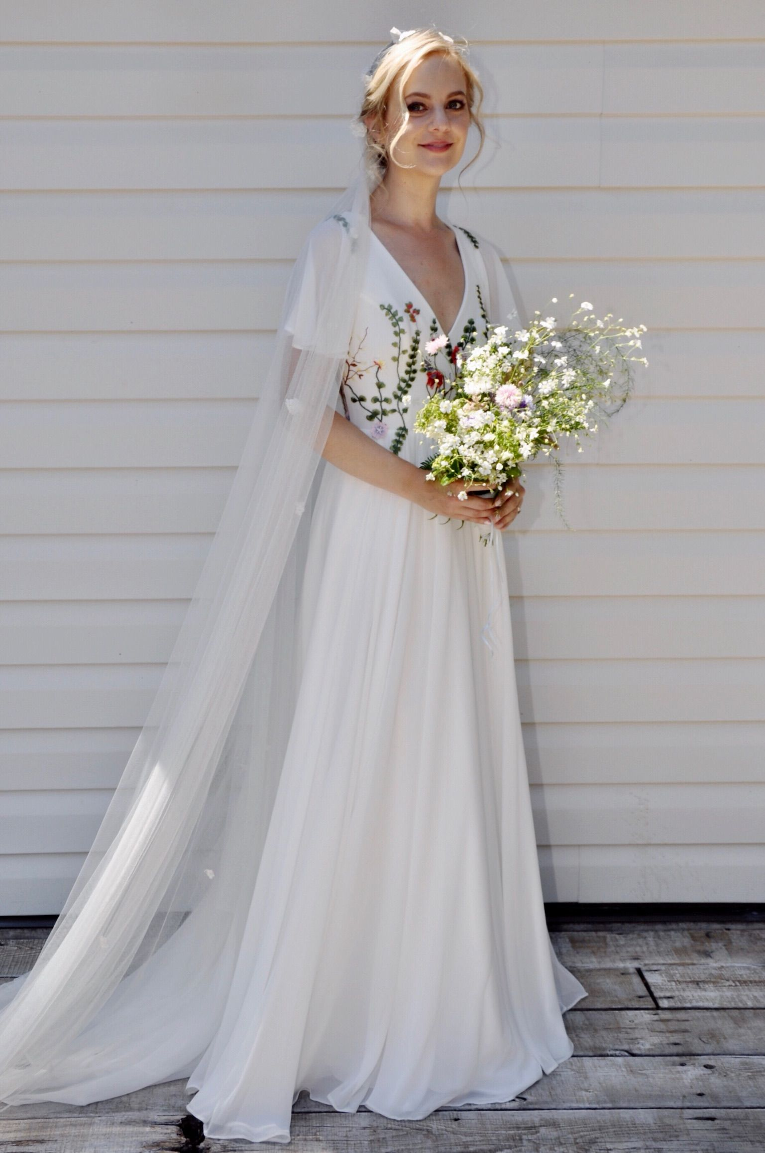 Embroidered bodice, customized back, flutter sleeves