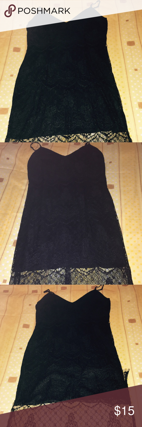 Black lace dress. Black lace dress size M zipper in the back cuts on the and of each side really comfortable. Forever 21 Dresses Midi