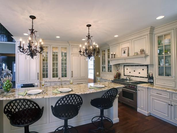 Nice cabinets, design, but don't like the dark chairs.