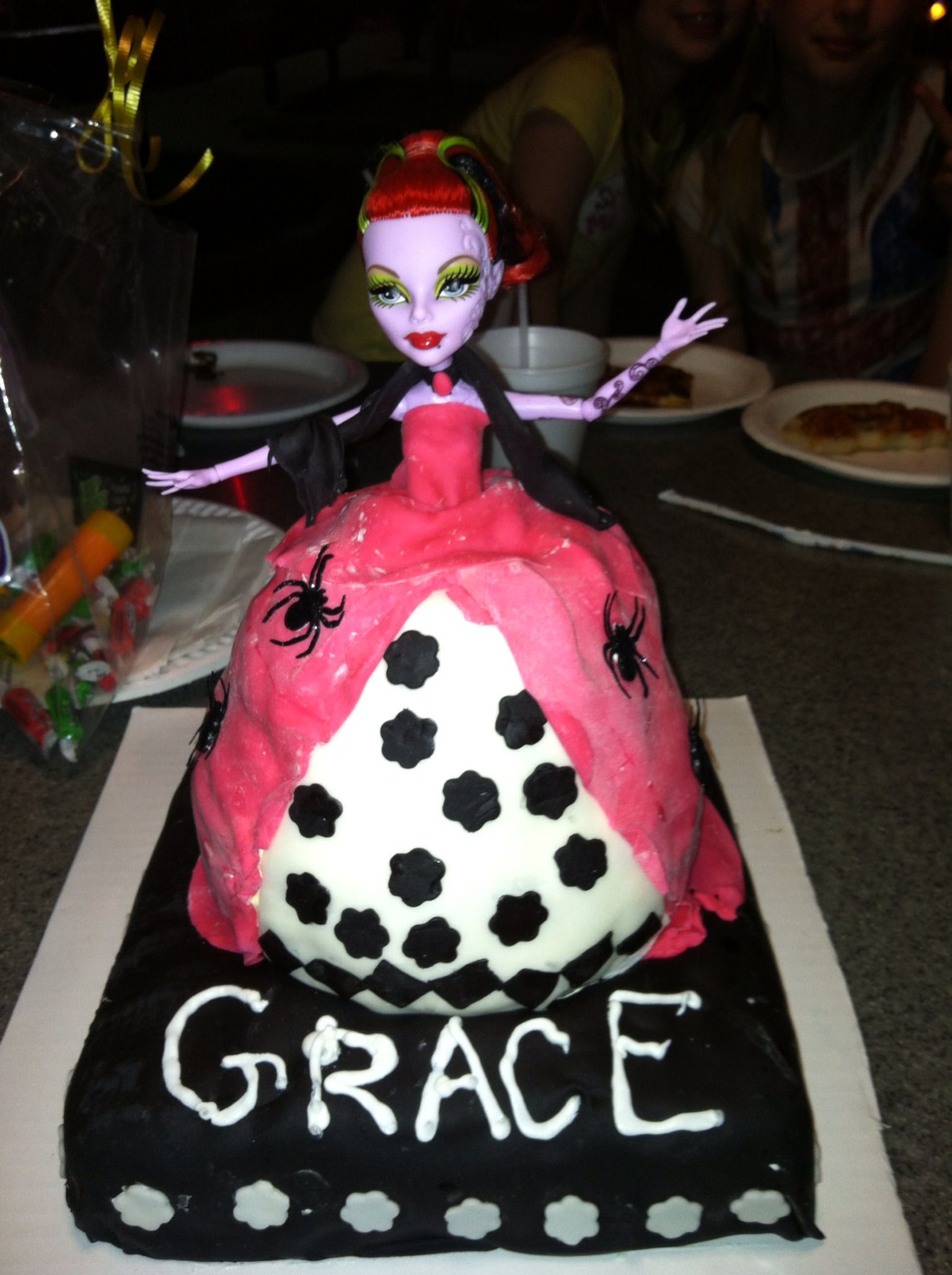 Monster high cake. I made this by sticking a monster high doll in the hole of a bunt cake. It stayed upright by sticking the feet of the doll in the bottom layer of cake. The dress is fondant.