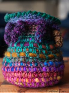 Coiled vessels using single crochet around wool roving